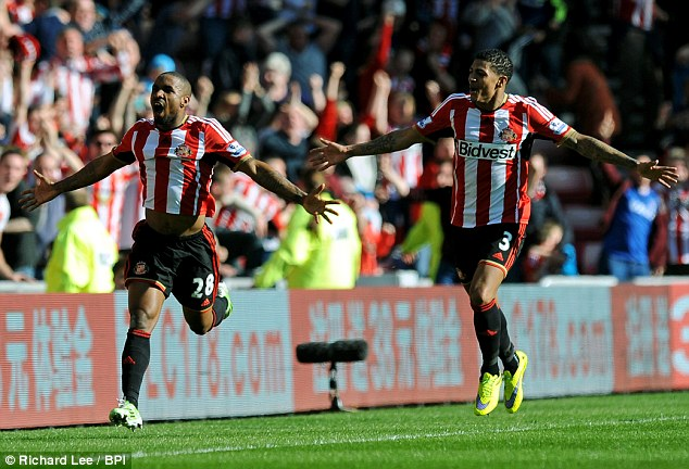 Defoe celebrates his stunning goal which earned the Black Cats a valuable three points on Sunday