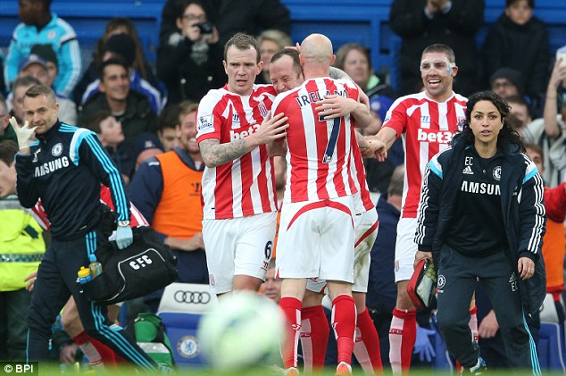 Adam gets a hug from Glenn Whelan (left) and Stephen Ireland after making it 1-1 against the league leaders