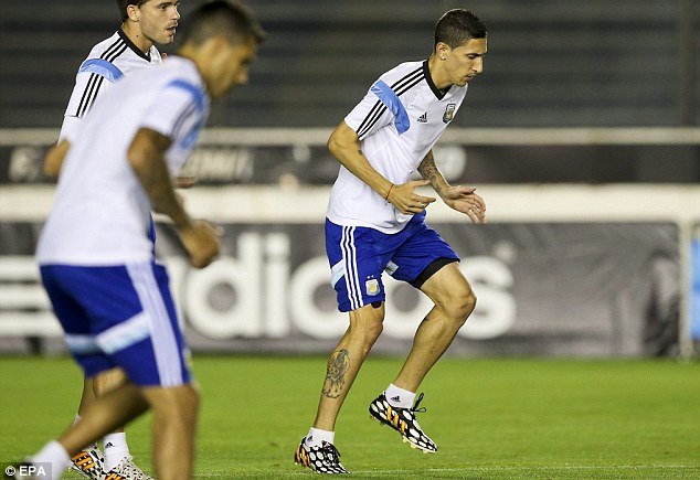 Training: Angel Di Maria (right) with his Argentina team-mates in Rio de Janeiro ahead of the final