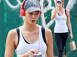 141495, Karlie Kloss, wearing a gym outfit, seen out and about in SoHo, NYC. New York, New York - Sunday August 23, 2015. Photograph: © PacificCoastNews. Los Angeles Office: +1 310.822.0419 sales@pacificcoastnews.com FEE MUST BE AGREED PRIOR TO USAGE
