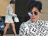 Please contact X17 before any use of these exclusive photos - x17@x17agency.com   Kris Jenner with boyfriend Corey Gamble looking amazing at almost 60 years old in a black and white dress and heels showing off her toned legs . August 24, 2015