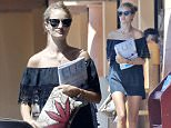 EXCLUSIVE: Rosie Huntington buys some magazine while Jason waits for her in the car in Malibu\n\nPictured: Rosie Huntington\nRef: SPL1108340  230815   EXCLUSIVE\nPicture by: Splash News\n\nSplash News and Pictures\nLos Angeles: 310-821-2666\nNew York: 212-619-2666\nLondon: 870-934-2666\nphotodesk@splashnews.com\n