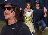 Norman Reedus poses with young fan during 2015 Wizard World Comic Con in Chicago held at Donald E. Stephens Convention Center \n\nPictured: Norman Reedus\nRef: SPL1108294  230815  \nPicture by: Ouzounova/Splash News\n\nSplash News and Pictures\nLos Angeles: 310-821-2666\nNew York: 212-619-2666\nLondon: 870-934-2666\nphotodesk@splashnews.com\n