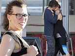 """Exclusive FOR MOL\n Mandatory Credit: Photo by Tania Coetzee/REX Shutterstock (4989060b)\n Milla Jovovich and Paul W.S. Anderson\n Milla Jovovich out and about, Cape Town, South Africa - 21 Aug 2015\n Keeping up the fitness program, Milla Jovovich and Paul Anderson enjoyed another workout session on Friday. The couple looked exhausted after a strenuous workout of climbing mountains, gym work and dance classes. After training, the couple recharged their energy with a quick caffeine stop at a nearby coffee shop, where  Milla wasted no time in lighting up a cigarette. The coffee stop seemed to have worked as they were spotted in a tight embrace before heading home. Jovovich has started preparing for her role and has already been undergoing fight rehearsals with her stunt team. Shooting will start in September on """"Resident Evil: The Final Chapter"""".\n"""