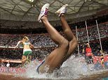Mandatory Credit: Photo by Xinhua/REX Shutterstock (4989842a)  Panama's Rolanda Bell falls into the water in the heats of the women's 3,000 metres steeplechase  IAAF World Athletics Championships, Beijing, China - 24 Aug 2015