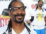 Mandatory Credit: Photo by Startraks Photo/REX Shutterstock (4989259b)\n Snoop Dogg\n AVC Celebrity Flag Football Game, Los Angeles, America - 23 Aug 2015\n 2015 Avc Celebrity Flag Football Game - Arrivals\n