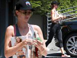 UK CLIENTS MUST CREDIT: AKM-GSI ONLY\nEXCLUSIVE: West Hollywood, CA - Supermodel Rosie Huntington-Whiteley leaves her gym this morning after getting in a sweaty workout session.  Rosie brought along a magazine with her for the light workout and a large glass water bottle.  Rosie made sure to give a nice tip for the valet before taking off.\n\nPictured: Rosie Huntington-Whiteley\nRef: SPL1108971  240815   EXCLUSIVE\nPicture by: AKM-GSI / Splash News\n\n