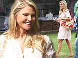 EXCLUSIVE TO INF.\nAugust 24, 2015: Christie Brinkley in a grapefruit printed blouse and skirt seen at the Hampton Classic Horse Show, Hamptons, NY.\nMandatory Credit: Matt Agudo/INFphoto.com Ref.: infusny-251