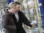 A GENERIC SHOT OF YOUNG FIRST-TIME BUYERS LOOKING AT PROPERTIES FOR SALE. estate for sale news . REXMAILPIX.