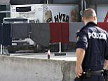 A police officer walks by a truck discovered abandoned on an Austrian motorway containing more than 70 bodies as it sits at a customs building with refrigeration facilities in the village of Nickelsdorf, Austria, August 28, 2015. The abandoned refrigerated lorry was found by an Austrian motorway patrol near the Hungarian border, with fluids from the decomposing bodies seeping from its back door. REUTERS/Heinz-Peter Bader