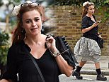 Helena Bonham Carter is seen in primrose hill shopping, dressed in stormtrooper boots and and big flowing skirt, helena smiled for the cameras.  Pictured: Helena Bonham-Carter Ref: SPL1110185  280815   Picture by: Neil Warner / Splash News  Splash News and Pictures Los Angeles: 310-821-2666 New York: 212-619-2666 London: 870-934-2666 photodesk@splashnews.com
