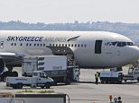 Toronto, Canada. 30th July 2015 -- File: Rumors circulate tha SkyGreece is going to file for bankruptcy, which the company denies. SkyGreece cancelled a flight from Toronto's Pearson International Airport to Greece on Thursday morning, just one day after cancelling three flights. -- Rumors circulate tha SkyGreece is going to file for bankruptcy, which the company denies. SkyGreece cancelled a flight from Toronto's Pearson International Airport to Greece on Thursday morning, just one day after cancelling three flights.