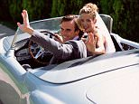 Newlyweds in sports car - Couple who have just married drive off in a sports car, happy and  waving. landscape colour lifestyle  adult adults bridegroom bride driving marriage waving Caucasian Caucasians convertible couple female IS555 IS555 057 leaving looking at camera male man newlywed newlyweds outdoors sitting smiling sports car two people wedding woman BRIDE DRIVING MOTOR CARS POSED BY MODELS ROMANCE SPORTS CARS WAVING WEDDINGS