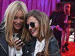 EXCLUSIVE ALL ROUNDER Caroline Flack and Laura Whitmore are seen in the VIP area at the Reading Festival. The girls looked to be having a great time as they hit the dance floor!\n28 August 2015.\n***DO NOT BYLINE***