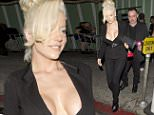 Courtney Stodden and her husband Doug Hutchison both carrying roses were seen leaving 'Warwick' Night Club in Hollywood, CA. Courtney was wearing a very open suit style jacket and black pants carrying a Blue 'Louis Vuitton' handbag.\n\nPictured: Courtney Stodden, Doug Hutchison\nRef: SPL1112370  300815  \nPicture by: SPW / Splash News\n\nSplash News and Pictures\nLos Angeles: 310-821-2666\nNew York: 212-619-2666\nLondon: 870-934-2666\nphotodesk@splashnews.com\n