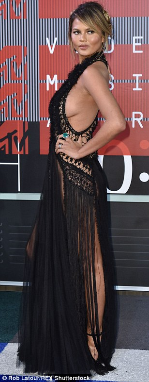 No wonder she landed a Sports Illustrated cover: Chrissy Teigen displayed her amazing figure in a sheer black creation