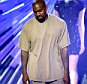 """LOS ANGELES, CA - AUGUST 30:  Recording artist Kanye West accepts the Video with a Social Message award for Big Sean's """"One Man Can Change The World""""  onstage during the 2015 MTV Video Music Awards at Microsoft Theater on August 30, 2015 in Los Angeles, California.  (Photo by Kevin Winter/MTV1415/Getty Images For MTV)"""