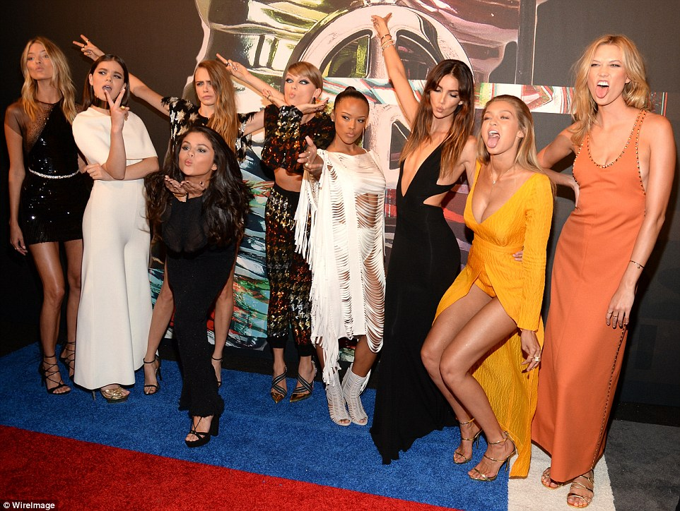 Goofing around: The group showed their silly sides as they posed together on the red carpet