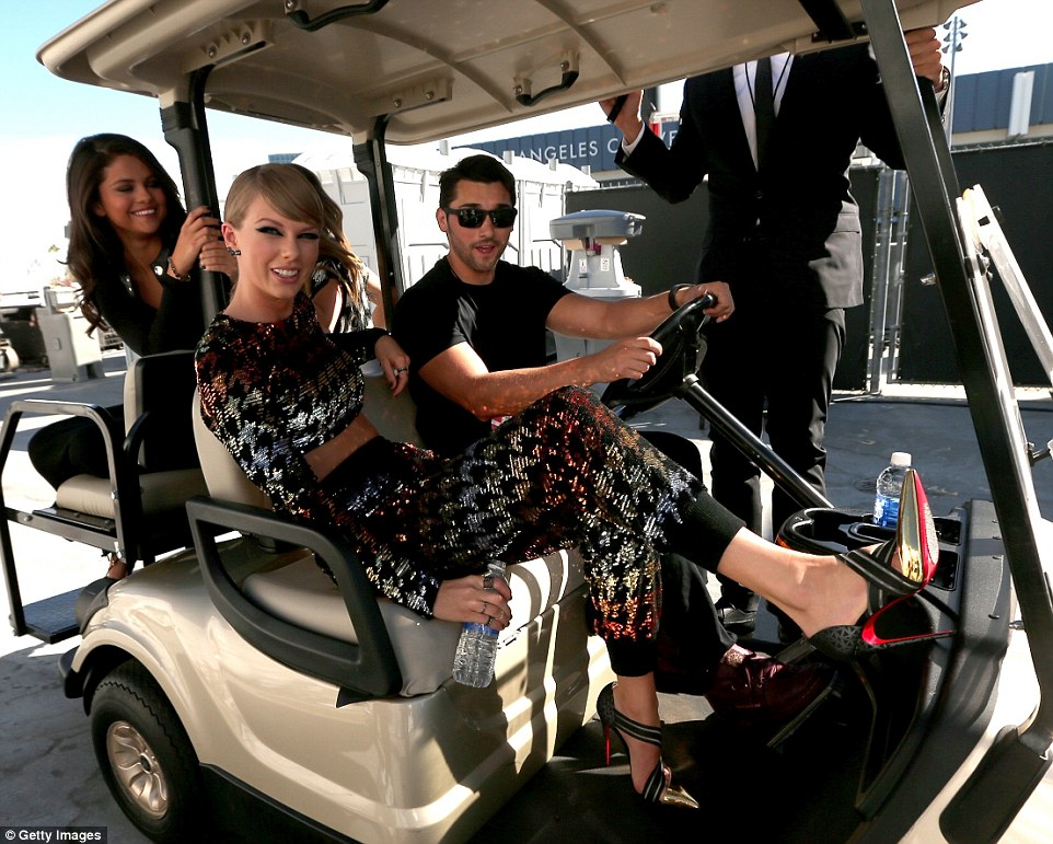 Thanks for the ride!: Taylor and Selena were given a lift to the red carpet in a golf buggy