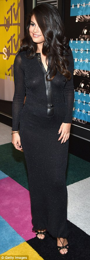 Sexy Selena: Miss Gomez kept things relatively low-key in a glittering black maxi dress by Calvin Klein, but still looked lovely
