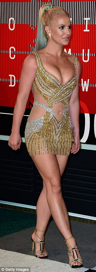 She's still got it: Britney Spears looked fantastic in her glittering gold and silver frock also by LaBourjoisie, with rainbow dip-dyed hair