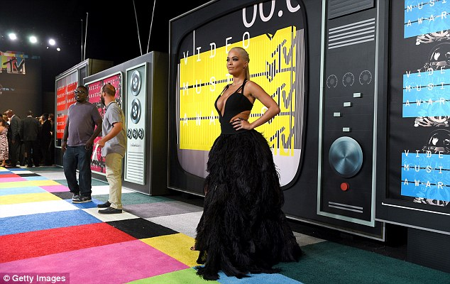 She's certainly a screen star! Rita poses in front of a giant TV set on the (multi-coloured) red carpe