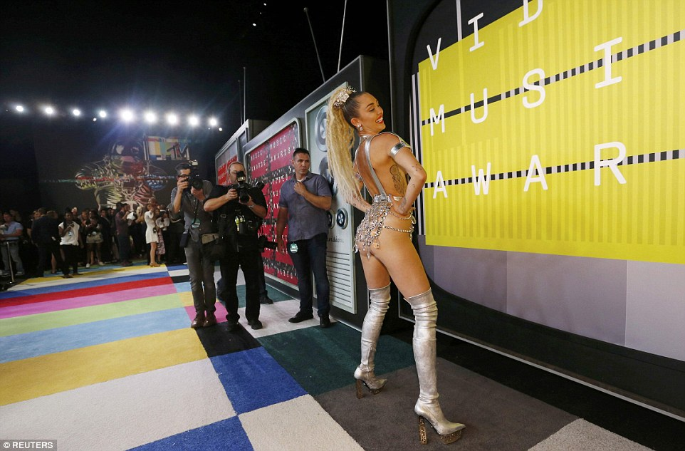 Driving them wild: As the cameras clicked away, the 22-year-old showed off her twerking skills in the barely there outfit