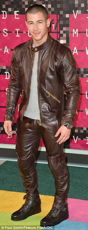 Stylish men: (L-R) Justin Bieber, Brooklyn Beckham and Nick Jonas all posed on the red carpet