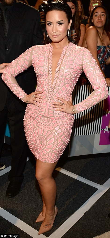 Looking Cool For The Summer: Demi Lovato left little to the imagination in a skintight and plunging pale pink Nicolas Jebrannumber