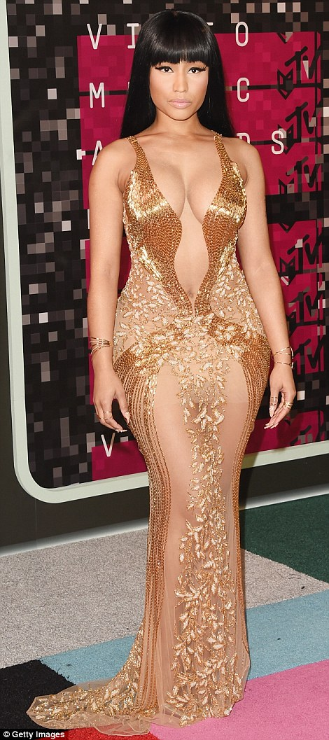 Less is more: Nicki Minaj also went for shock value in a gold plunging LaBourjoisiedress, showcasing her ample assets