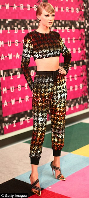 Hot metal: The 25-year-old certainly made an impression in an Ashish gold, silver and bronze sequined houndstooth crop top and trousers