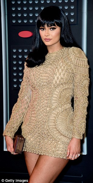 Copy-cat: Lately, Kylie's fashion choices have drawn repeat comparisons of her to her fashion icon sister Kim, and the Balmain micro-mini is just the latest