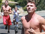 Picture Shows: Ryan Phillippe  August 29, 2015\n \n **Min Web / Online Fee £400 for set **\n \n Actor Ryan Phillippe and his son Deacon spotted out for a jog in Beverly Hills, California. While Ryan jogged, Deacon rode a motorized scooter.\n \n Exclusive  All Rounder\n UK RIGHTS ONLY\n \n Pictures by : FameFlynet UK © 2015\n Tel : +44 (0)20 3551 5049\n Email : info@fameflynet.uk.com