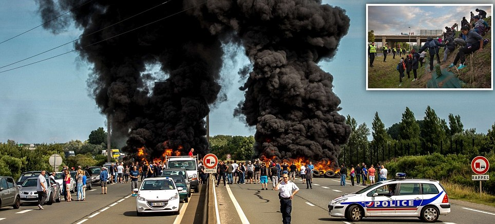 Striking ferry workers burn tyres on Calais roads causing chaos for Brit holidaymakers
