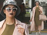 141686, EXCLUSIVE: Kat Graham seen making her way through LAX wearing a camouflage hat. Los Angeles, California - Saturday August 29, 2015. Photograph: © PacificCoastNews. Los Angeles Office: +1 310.822.0419 sales@pacificcoastnews.com FEE MUST BE AGREED PRIOR TO USAGE