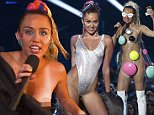 Show host Miley Cyrus shields herself on stage at the 2015 MTV Video Music Awards in Los Angeles, California August 30, 2015.  REUTERS/Mario Anzuoni