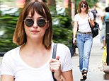 """New York, NY - """"Fifty Shades of Grey"""" star Dakota Johnson is casual cool as she is seen in New York City running errands on a warm cloudy day. Dakota wore a white fitted t-shirt tucked into a pair of cuffed denim jeans as she rocked a the cute and classic bob while walking down the street. \nAKM-GSI        August 30, 2015\nTo License These Photos, Please Contact :\nSteve Ginsburg\n(310) 505-8447\n(323) 423-9397\nsteve@akmgsi.com\nsales@akmgsi.com\nor\nMaria Buda\n(917) 242-1505\nmbuda@akmgsi.com\nginsburgspalyinc@gmail.com"""