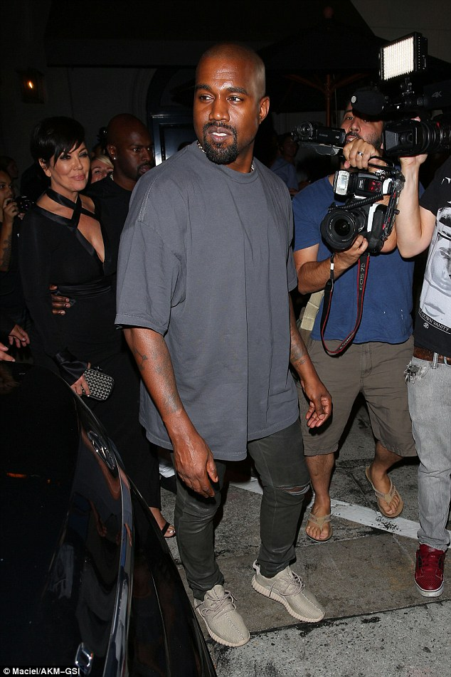 Proud moment: Kanye's mother-in-law Kris looked proud as punch as she followed the VMAs winner out of the restaurant