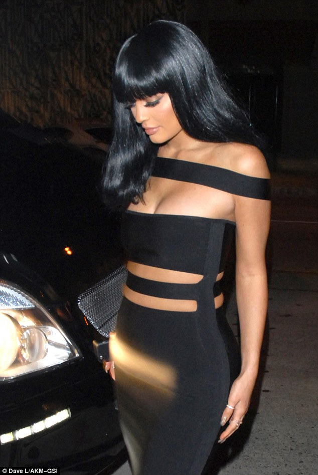 Quick change: Kylie showed off her figure in her risque little black dress as she headed inside the restaurant following the star-studded awards show at Los Angeles' Microsoft Theater