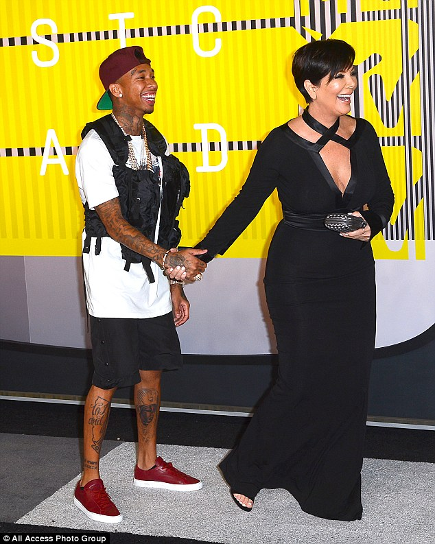 One of the family: As Kylie posed with her sisters when she arrived at the venue, Tyga joked around with his girlfriend's mum Kris Jenner on the red carpet