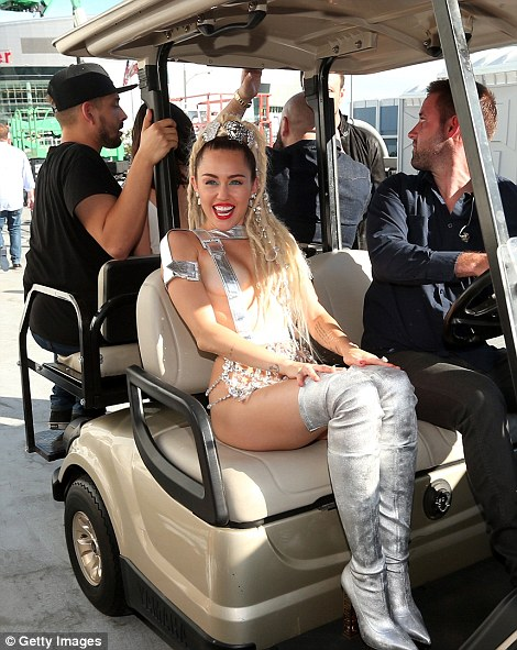 Arriving in style: Miley was chauffeured in a golf cart to the theater
