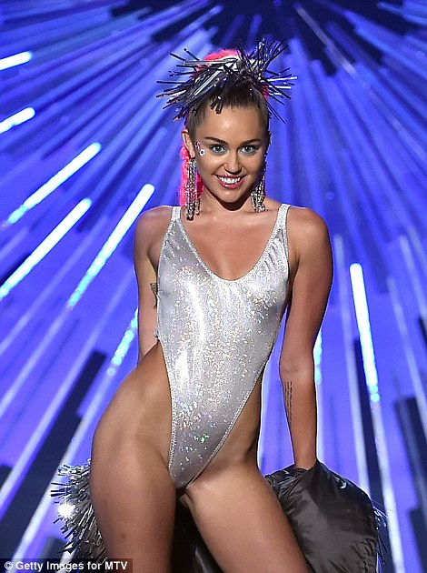 Strip tease: The emcee was quick on the draw when it came to taking her clothes off