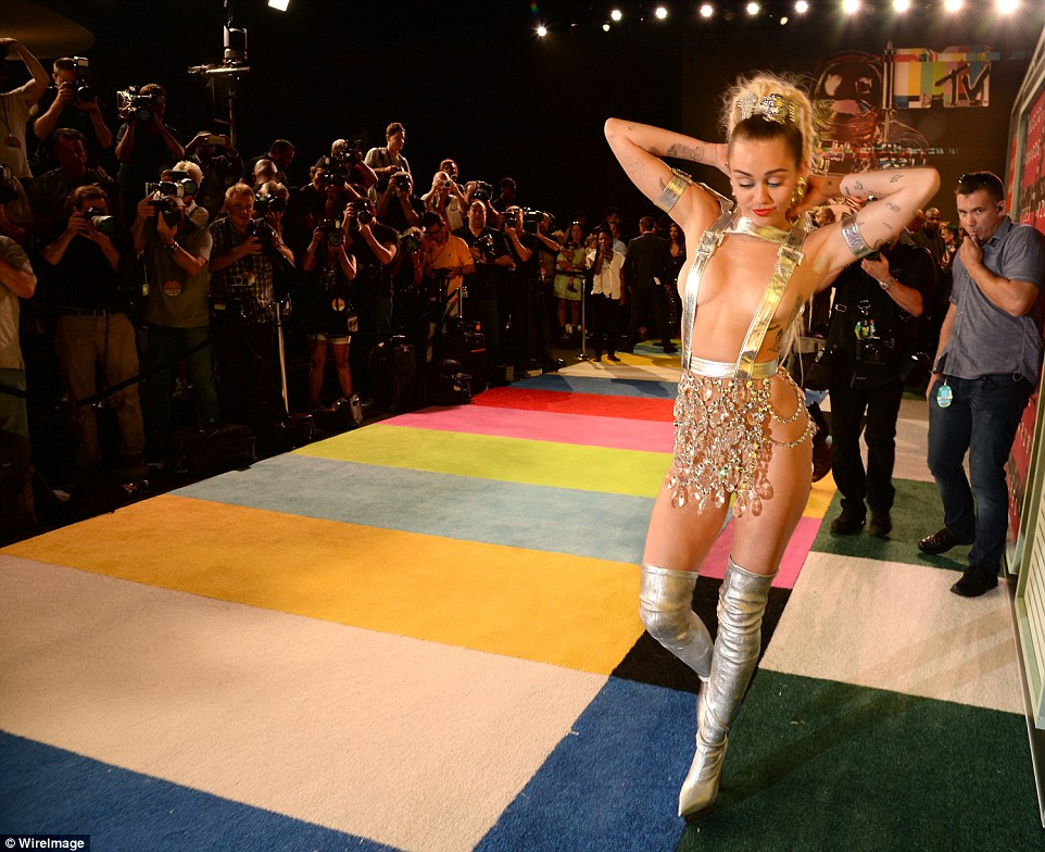 No turning this off! Miley strutted down the carpet as she was followed for a crew of photographers