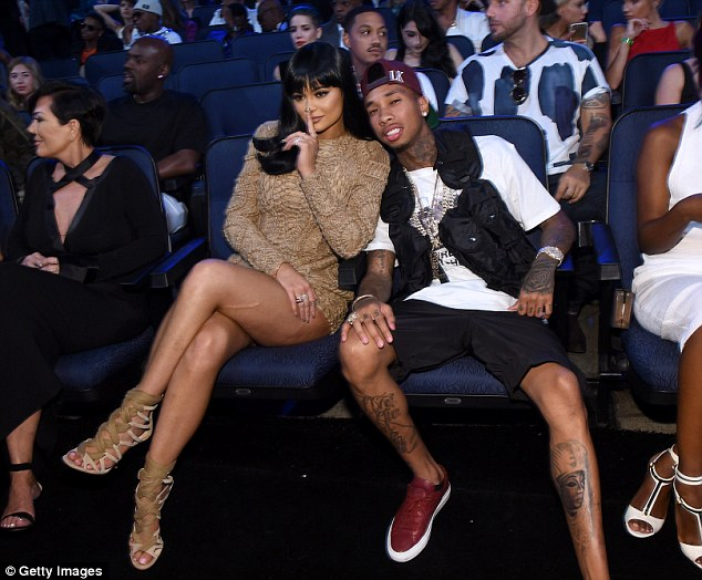 Cute couple: Kylie Jenner was joined by her rapper boyfriend Tyga, 25, at the MTV VMAs on Sunday, with the two cuddling up to each other in their seats