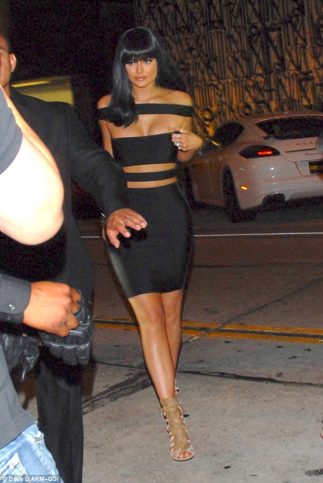 Time to party: Kylie Jenner wowed in a racy bondage style dress as she joined her family for a dinner at Craig's following the MTV VMAs in Los Angeles on Sunday