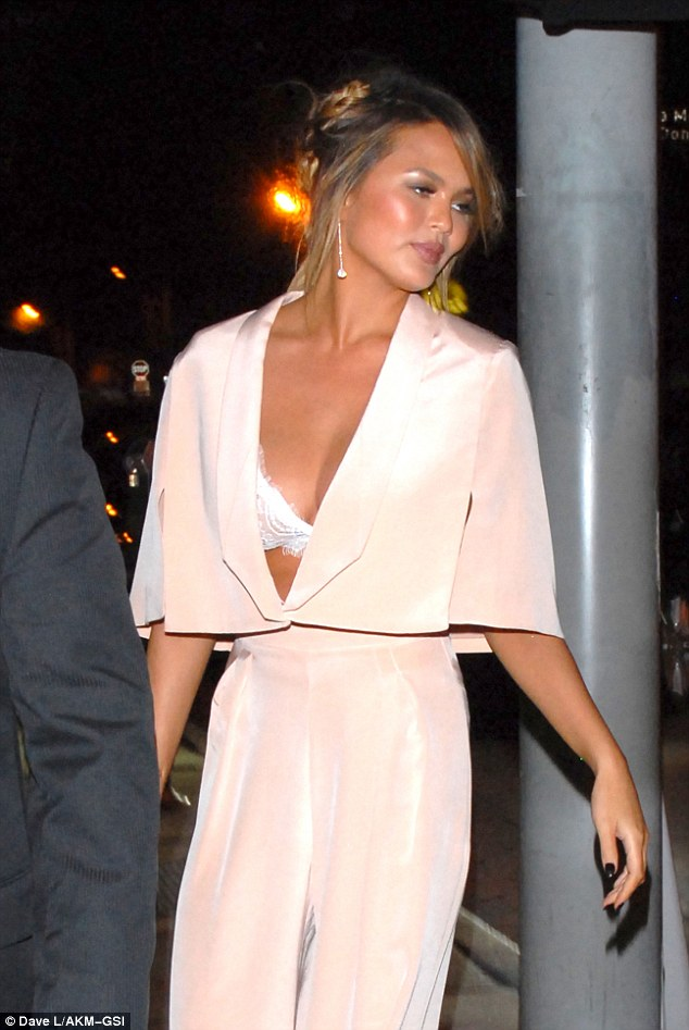 Daring: The blush coloured number featured a plunging neckline which showed off the star's lace bra