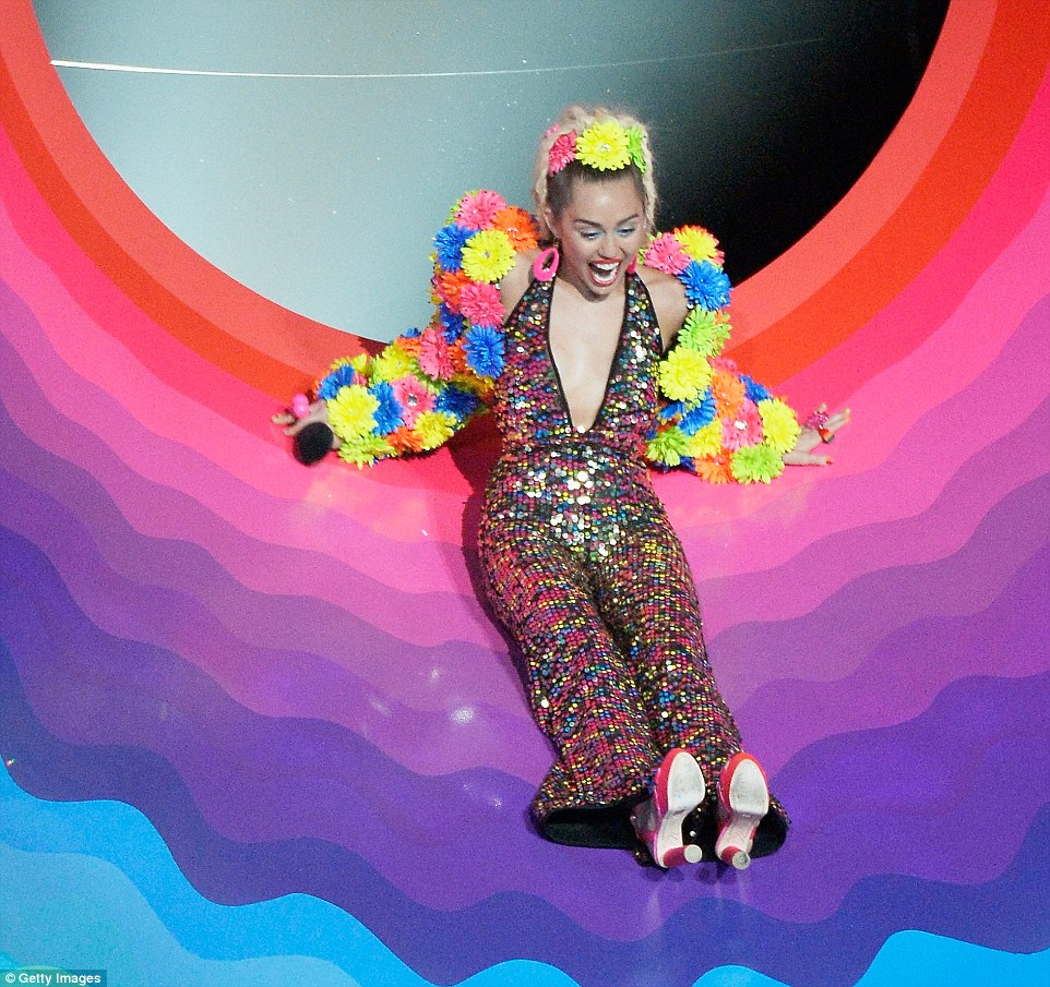 Sliding in: At the opening, she rode a psychedelic slide onto the stage