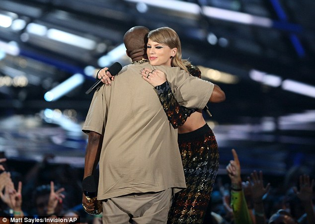 All's good: Kanye West and Taylor Swift embraced after she presented him with the Video Vanguard Award