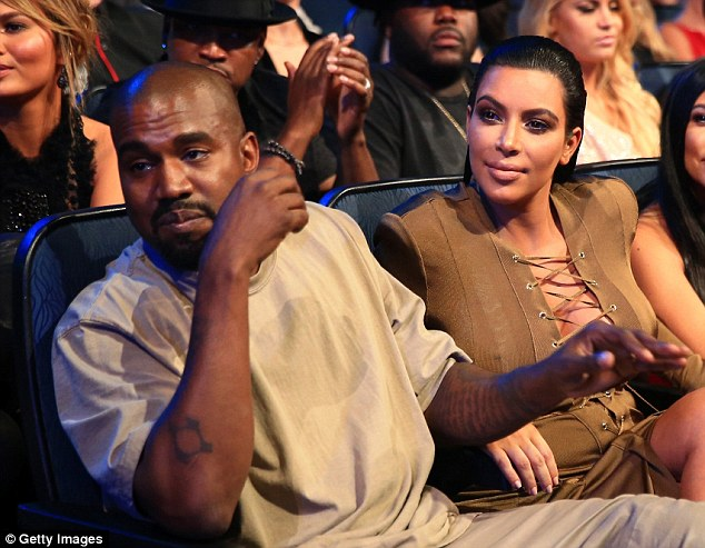 Feeling sleepy? Kanye and Kim during the show, where at one point he laid down on her and pretended to take a nap