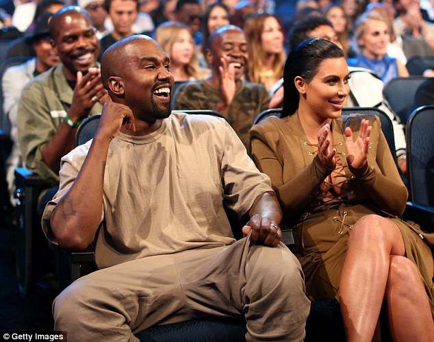 VIPs: Kanye and Kim shared a laugh during the star-studded show on Sunday night